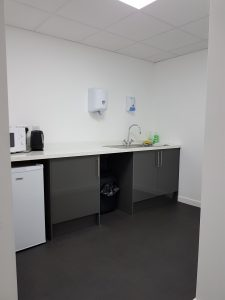 Kitchen with fridge, microvwave, kettle